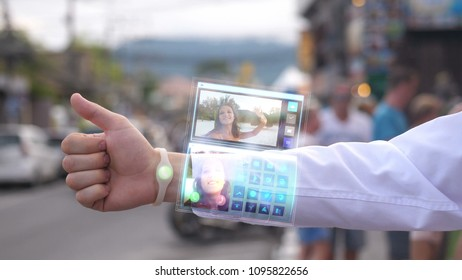 Businessman call the pretty wife who smiles and waves hand from the phone that appears in hologram futuristic clock. Augmented reality.