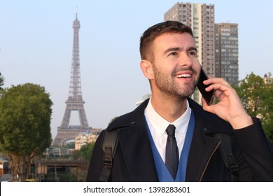 Businessman calling by phone from Paris