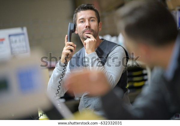 businessman calling at warehouse