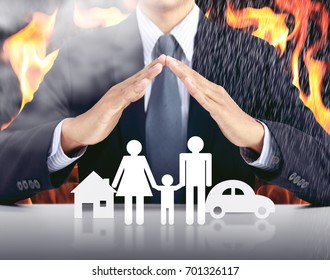 businessman, car, family, house with fire background, insurance concept
