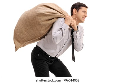 Businessman carrying a burlap sack on his back isolated on white background