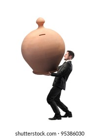 Businessman carrying a giant money box