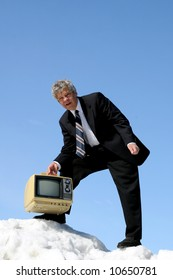 Businessman carrying an old TV