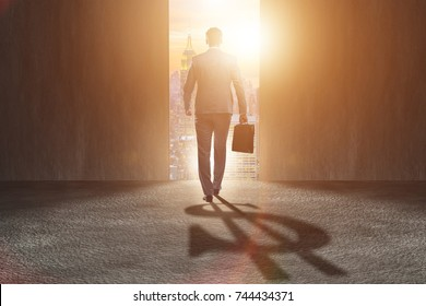 Businessman casting dollar shape shadow in business concept