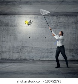 Businessman catching idea