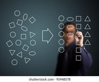 businessman categorizing geometry drawing
