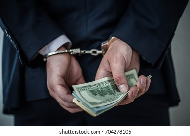 A businessman caught with handcuffs on for corruption and stealing fraud and bribery of banks in a million dollars.