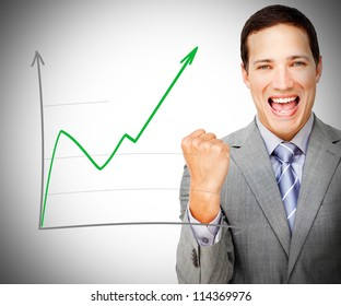 Businessman celebrating behind increasing graph on grey background