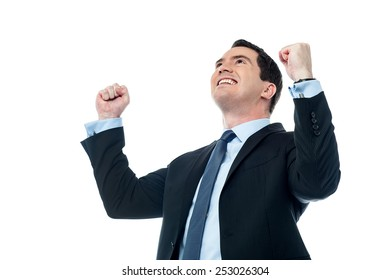 Businessman celebrating his success with raising arms
