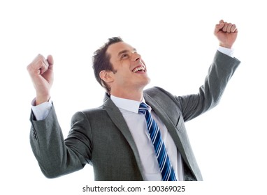 Businessman celebrating success with arms up isolated over a white background