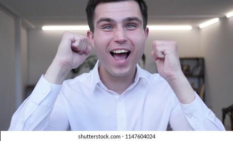 Businessman Celebrating Success  Gesture in Offcie