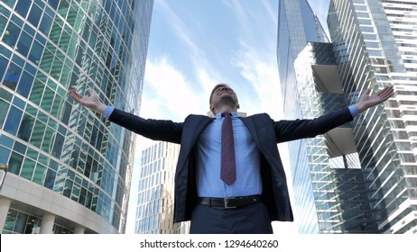 Businessman Celebrating Success Outside Office