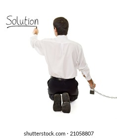 Businessman in chains searching and finding a solution - isolated