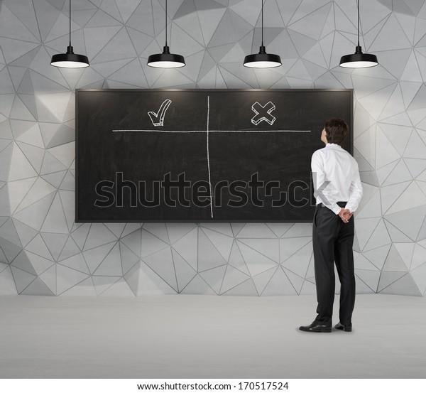 Businessman and chalkboard