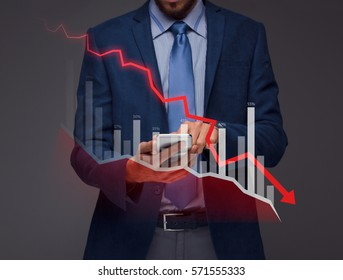 Businessman with chart in the fall, economy going down.