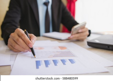 Businessman check business profits with on project at office desk in office. Concept investor and finance morning light. Concept business and financial
