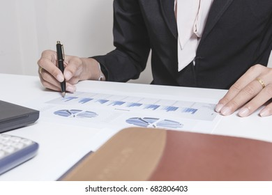 Businessman check seriously analyzes a finance report investor colleagues discussing new plan financial graph data. bank managers task. Concept business and finance ,Account analyzes planing