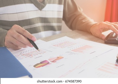 Businessman check seriously analyzes a financial reports. Financial reports are set of documents prepared by an administrative team at the end of an accounting period. Concept business finance