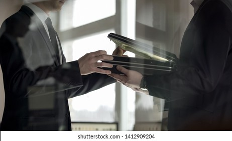 Businessman checking dollars in briefcase, kickback in illegal cooperation