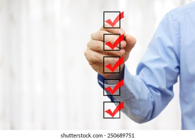 businessman checking final  mark on checklist