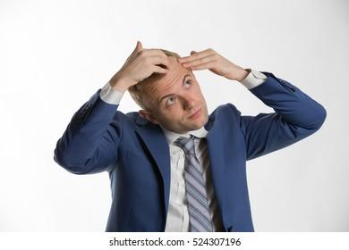 Businessman checking his hair indicating hair loss