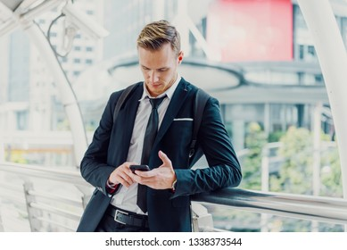 Businessman checking his social media on smartphone