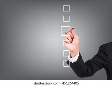 Businessman checking mark checklist marker on gray background