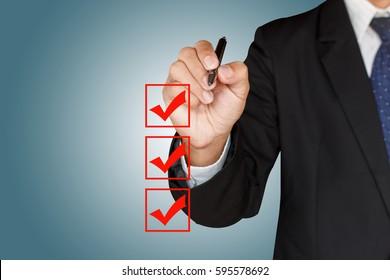 Businessman checking mark checklist marker on blue background