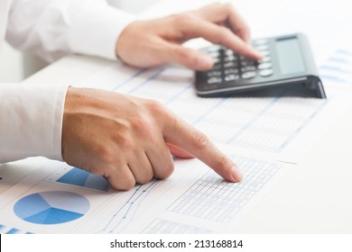Businessman checking numbers on a document
