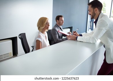 Businessman checking at reception desk