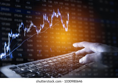 Businessman checking stock or forex data on laptop and smart phone. finance and business concept.