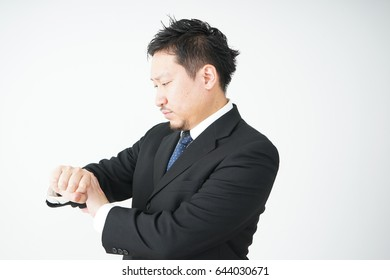 Businessman checking time