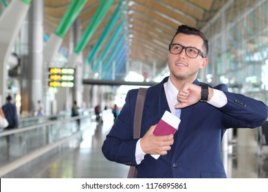Businessman checking the time in the airport