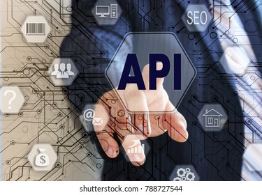 The businessman chooses the API, Application Programming Interface on a touch screen. Concept API