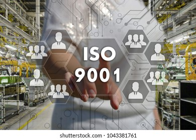 The businessman chooses  button  ISO 9001 on the touch screen with a futuristic background .The concept   ISO 9001.