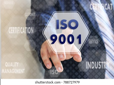 The businessman chooses ISO 9001,  presses a button on the touch screen