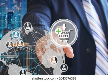 The businessman chooses on the shopping cart on the touch screen with a futuristic background.The concept of online . Auctions.online store. Shopping cart icon. Ecommerce.