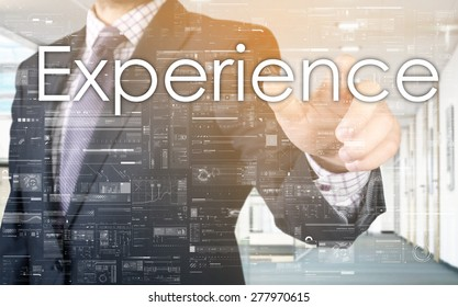 the businessman is choosing Experience from touch screen