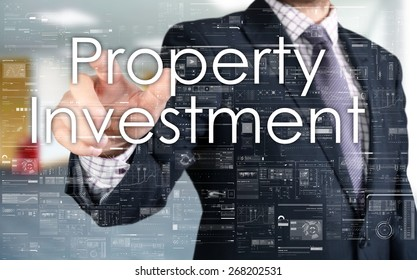 the businessman is choosing Property Investment from touch screen