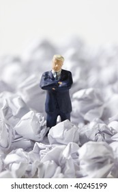 The businessman circled by a great deal of form trash.