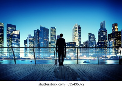 Businessman Cityscape Skyline Night Light Vision Concept