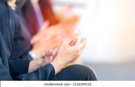 Businessman clapping hands during seminar or teamwork meeting. Congratulation to  team member who receives award after business project success. Succeed from team collaboration, diversity idea, unity