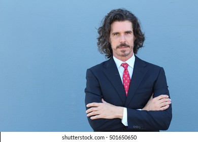 Businessman in classic suit with salt and pepper long hair