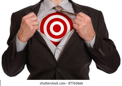 Businessman in classic superman pose tearing his shirt open to reveal target symbol on chest