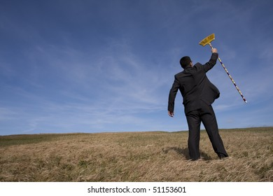 businessman cleaning the field with a broom