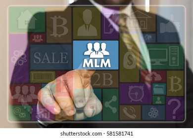 The businessman  clicks the button MLM on the touch screen with metro style graphic user interface. The concept of multi-level marketing.
