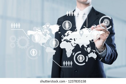 Businessman clicks a gear with planet earth and iso word button on a virtual panel. ISO Certification Quality Global Standards. Management Business Certified concept.