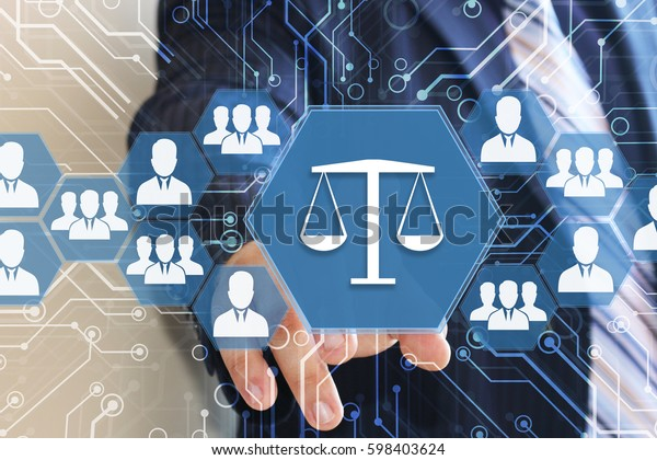 The businessman clicks on the button LIBRA with the security shield in the web network . The concept of security of justice .Business, security, Internet, court, Tribunal.