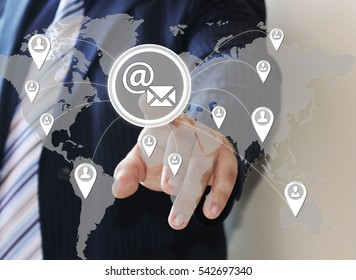 The businessman clicks on the email button on virtual screen with the social network. The concept of email marketing.