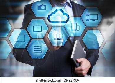 Businessman clicks on the icon with the cloud. cloud technology concept. internet concept.